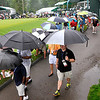 Brad Davis/The Register-Herald<br /> Fans move about hunkered under umbrellas as they take in second round Greenbrier Classic action on a soggy Friday in White Sulphur Springs.