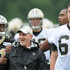 Rick Barbero/The Register-Herald<br /> Kenan Lewis, left and Zach Strief with special team coach Greg McMahon during the New Orleans Saints first day of practice held at The Greenbrier Resort in White Sulphur Springs Thursday morning.