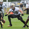 Rick Barbero/The Register-Herald<br /> Terrence Freederick, left, Josh Hill and Terron Armstead during the New Orleans Saints first day of practice held at The Greenbrier Resort in White Sulphur Springs Thursday morning.