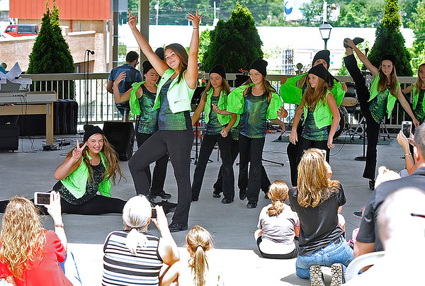 Brad Davis/The Register-Herald<br /> Performers with the School of Harmony's Leaps of Faith dance group wrap up their routine as the crowd in attendance looks on during Friday in the Park yesterday afternoon.