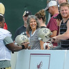Rick Barbero/The Register-Herald<br /> Cyril Lemon, left, signs autographs for spectators after the New Orleans Saints first day of practice held at The Greenbrier Resort in White Sulphur Springs Thursday morning.