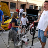 Brad Davis/The Register-Herald<br /> Beckley residents Bryan Trump and his wife Peggy (left holding leash) didn't mean to steal some of the show along Neville Street when they brought their two great danes Leonardo, right, and Alexis, left, along to the auto show.