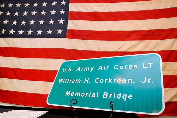 """Brad Davis/The Register-Herald<br /> A replica of a road sign dedicating a bridge on Rt. 60 near Lewisburg to World War II bomber pilot William """"Billy"""" Corkrean, Jr. sits on display inside the North House Museum prior to ceremony Friday evening. Corkrean was shot down and killed during a mission over Belgium. He went down with his plane, but not before the rest of the crew bailed out and survived with the exception of the co-pilot, who'd been killed when the plane was hit."""