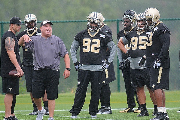 Rick Barbero/The Register-Herald<br /> Defensive line coach Bill Johnson taks with players during the New Orleans Saints first day of practice held at The Greenbrier Resort in White Sulphur Springs Thursday morning.