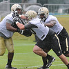 Rick Barbero/The Register-Herald<br /> Cyril Lemon, left, Cole Manhart and Nick Becton doing drills during the New Orleans Saints first day of practice held at The Greenbrier Resort in White Sulphur Springs Thursday morning.