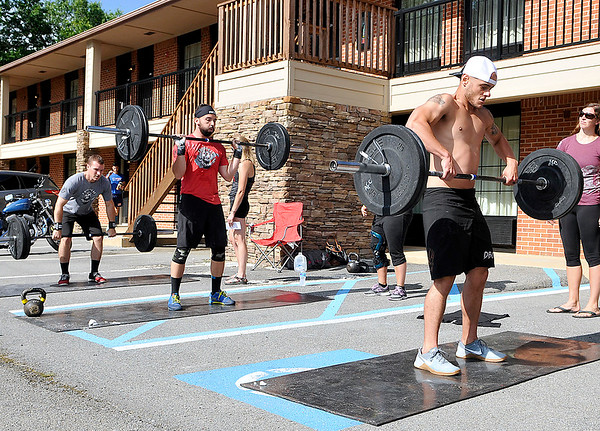 Brad Davis/The Register-Herald<br /> CrossFit enthusiasts labor through an event as they compete in the 2nd annual Coalfield War Games Saturday morning at the Skyline Lodge in Ghent. Around 140 participants from CrossFit clubs all over Virginia and West Virginia turned out to physically beat the heat with events utilizing weights, kettle balls, old fashioned pushups and distance running.