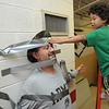 Rick Barbero/The Register-Herald<br /> Yamer Mayo, kindergarten student in Tresa Martin's class at Coal City Elementary School, helps duck tape the school principal David Null to the wall. For every dollar donated students got three foot of duck tape to put on Mr. Null. Portion of the proceeds will be donated to Camp Cool. This is for kids 6-21 years of age with primary diagnosis of celebral palsy and spina bifida.