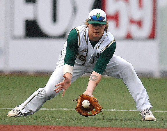 Brad Davis/The Register-Herald<br /> West Virginia third baseman Mark DeYoung fields a ground ball during the Miners' series opener against the Butler Blue Sox Thursday night at Linda K. Epling Stadium.