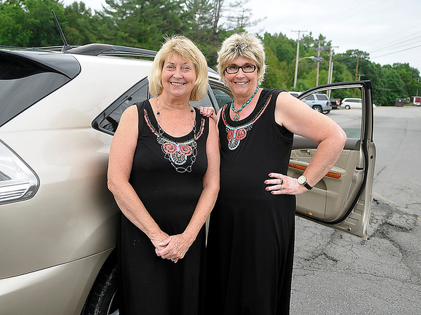 Brad Davis/The Register-Herald<br /> Caregiver Charlotte Dickens, left, and cancer survivor Kay Kidd, right, pose for a quick photo as they arrive at the American Cancer Society's Relay for Life Survivor's Dinner Friday evening at Woodrow Wilson High School.