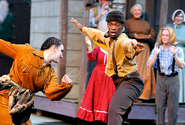 Brad Davis/The Register-Herald<br /> Actors perform a musical scene during Theatre West Virginia's production of Honey in the Rock June 19 at Grandview Park's Cliffside Amphitheatre.