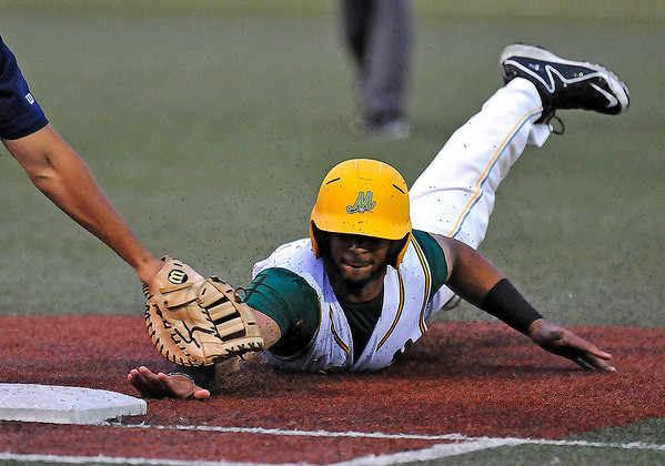 Brad Davis/The Register-Herald<br /> West Virginia's Samuel De La Cruz is tagged out by Butler 1st baseman David Marcus after being picked off at 1st base during the bottom of the 5th inning of the Miner's series opener against the Blue Sox Thursday night at Linda K. Epling Stadium.