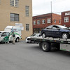 Brad Davis/The Register-Herald<br /> A pair of wrecked vehicles are removed from the United Bank parking lot Tuesday evening after being involved in an accident at the intersection of Prince and Kanawha Street.