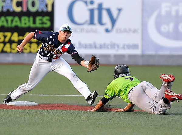 Brad Davis/The Register-Herald<br /> Miners shortstop Dom Iero reaches out to catch the throw as Springfield's Jesus Caporal dives head first on a steal attempt Friday night at Linda K. Epling Stadium. The ball would get past Iero and Caporal would be safe on the play.