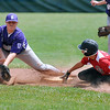 Brad Davis/The Register-Herald<br /> Beckley's Noah Rakes manages to scoop up the throw down to second, but not before Oak Hill's Seth Wolfe slides in safe on a wild pitch during Little League All-Star action Sunday afternoon at the Beckley Little League fields.