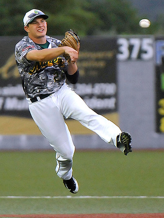 Brad Davis/The Register-Herald<br /> Miners shortstop Dom Iero makes a running play on a soft ground ball to retire Springfield's Jesus Caporal Thursday night at Linda K. Epling Stadium.