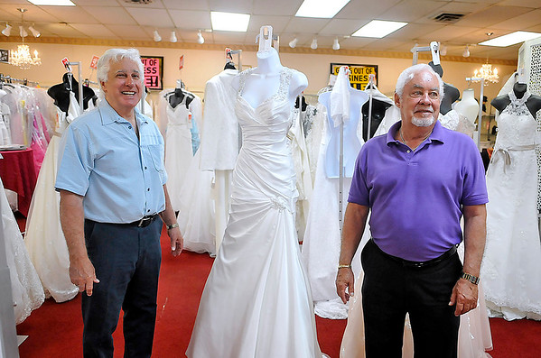 """Brad Davis/The Register-Herald<br /> Harvey's Bridal & Fashions owners Tom, left, and Gene Harvey reflect on four decades in business as they chat with The Register-Herald in their store Wednesday afternoon. After 40 years, the Harveys are closing the shop in a few months, though not for a lack of business. The brothers and their families simply want to """"slow down,"""" saying that getting back down to a 40 hour work week would feel like part-time."""