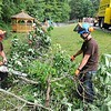 Rick Barbero/The Register-Herald<br /> Brandon Williams, left, Rob Worrells and Jeff Bevil, with Mossy Rock Tree Services, clearing trees away to help expand the playground area at Daniels Elementary School.