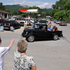 Brad Davis/The Register-Herald<br /> Pax resident Sharon Holstein, lower right, and friend Marjorie Shuck-Kallas wave to friends and acquaintances as they pass through downtown in classic cars and trucks during the town's annual Reunion Parade Saturday morning in Fayette County.