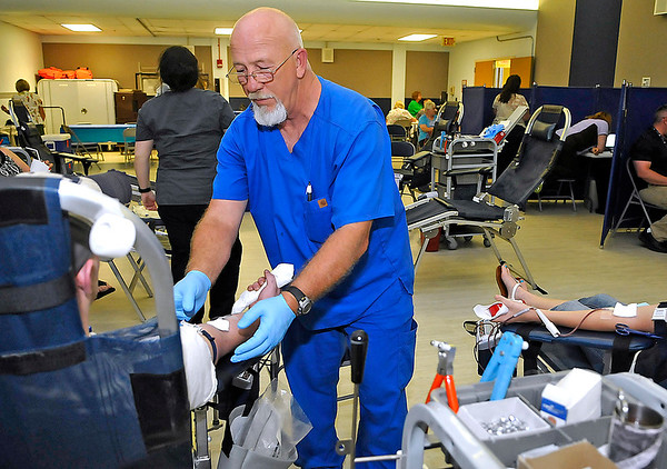 Brad Davis/The Register-Herald<br /> Jimmy Hise, Phlebotomist with Virginia Blood Service, draws from donors during the VA Medical Center's open house Summer of Service event Tuesday afternoon at the Beckley location.