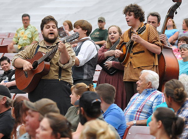 Brad Davis/The Register-Herald<br /> Theatre West Virginia actors perform a musical scene during the kick off of its 55th season Friday night at Grandview Park's Cliffside Amphitheatre.