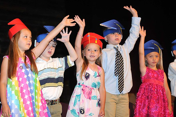 Rick Barbero/The Register-Herald<br /> Charlotte Robertson, left, Joey DellaMea, Carly Kennedy, Ben Fitzwater and Lilly Garcia, students in Marybeth Garcia's class, wave goobye to the school year during Crescent Elementary School Pre-K graduation Ceremony Friday morning.
