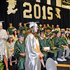 Brad Davis/The Register-Herald<br /> Graduating Wyoming East seniors make their way forward to collect their diplomas during the school's commencement ceremony Sunday afternoon in New Richmond.