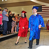 Brad Davis/The Register-Herald<br /> Friends and family watch for their kids as Midland Trail High School seniors walk to their seats during the opening moments of the school's commencement ceremony Friday night at the Summersville Arena and Conference Center.