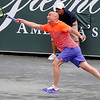 Brad Davis/The Register-Herald<br /> Professional tennis legend Andre Agassi reaches out to return the ball as he squares off against old rival and returning star Pete Sampras during the Greenbrier Tennis Classic at the brand new Center Court at Creekside Stadium Saturday afternoon in White Sulphur Springs.