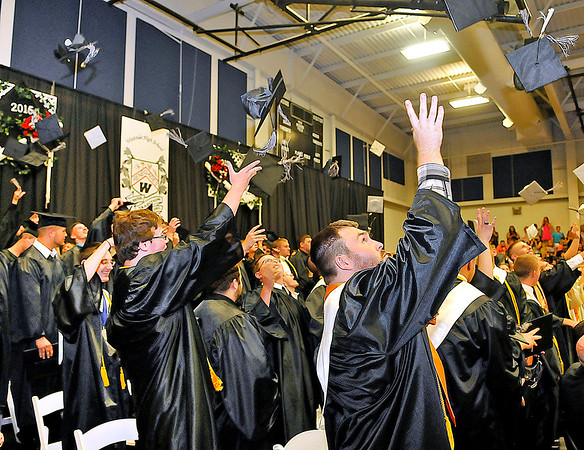 Brad Davis/The Register-Herald<br /> Westside seniors toss their caps into the air as the school's graduating class of 2015 erupts in celebration at the conclusion of their commencement ceremony Sunday afternoon in Clear Fork.
