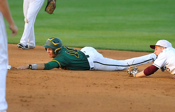 Brad Davis/The Register-Herald<br /> Greenbrier East's Tyler Canterbury reaches out to grab second base after somehow making it safely through a long rundown during the Spartans' three run 4th inning Thursday night at Charleston's Appalachian Power Park.