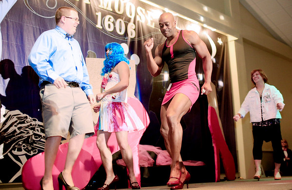 """Chris Jackson/The Register-Herald<br /> Members of Group C, Chase Barton, from left, Frank Constantino, Matthew Nelson and Jon White, dance to """"Usher Ludacris"""" by Yeah! during the second annual BNI Hunks In Heels at the Beckley Moose Lodge on Friday."""
