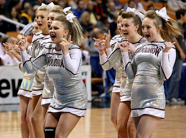 Brad Davis/The Register-Herald<br /> The Woodrow Wilson cheerleaders perform during a break in the Flying Eagles' game against Parkersburg South Friday night.