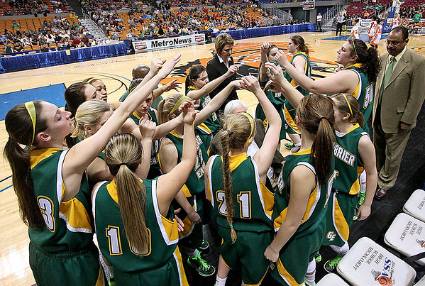 Brad Davis/The Register-Herald<br /> The Spartans rally for one last push during a timeout late in Greenbrier East's tough loss to South Charleston Thursday night at the Charleston Civic Center.