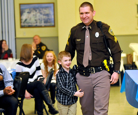 Brad Davis/The Register-Herald<br /> Cpl. Jamie Wilhite with the Beckley Police Department is joined by his four-year-old son Tyler as he accepts a Fraternal Order of Police Distinguished Service Award Friday night at the Beckley Moose Lodge.