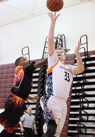 Brad Davis/The Register-Herald<br /> Charleston Cavaliers player Gunner Daughtery scores as WV Burn's Gunner Lattimore defends during the 6th grade Biddy Buddy championship game Sunday afternoon at Woodrow Wilson High School.