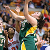 Brad Davis/The Register-Herald<br /> Greenbrier East's Sydney Nunley drives to basket as South Charleston's Bri Moore tries to stop her Thursday night at the Charleston Civic Center.