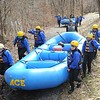 Rick Barbero/The Register-Herald<br /> Parents and students from Mary, Queen of Peace Catholic School in Mandeville, LA, preparing for the first New River raft trip of 2015. Ace Adventure Resort guided the trip from Stonecliff to Cunard section upstream of the gorge.