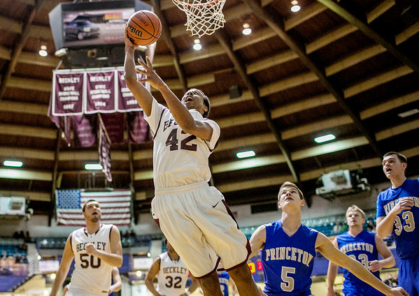Chris Jackson/The Register-Herald<br /> Woodrow Wilson's Stephen Beasley (42) puts in a layup as Princeton's hosted Princeton's (5) during the second quarter of their sectional Friday at the Beckley-Raleigh County Convention Center in Beckley.
