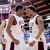 Chris Jackson/The Register-Herald<br /> Woodrow Wilson's Breland Walton (52) is congratulated by Brent Osborne (44) and Tarek Payne (32) after making a layup while being fouled during the second quarter of their Region III Co-Final against George Washington at the Beckley-Raleigh County Convention Center in Beckley.Walton converted the foul shot following the play.