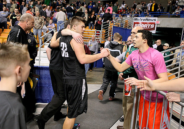 Brad Davis/The Register-Herald<br /> Westside senior Justin Cogar is congratulated for a stellar career by a fan as he exits the court with head coach Nick Cook (arm around Cogar) following the Renegades' loss to Poca Friday night at the Charleston Civic Center.