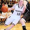 Brad Davis/The Register-Herald<br /> Westside's Will Fox drives around PikeView's Seth Meadows Wednesday night in Clear Fork.
