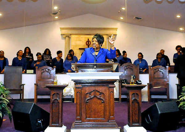 Brad Davis/The Register-Herald<br /> Evangelist Jeanette Thomas, Associate Pastor at Heart of God Ministries, gets the party started with song as the Total Mass Choir comes to life behind her during the opening moments of the church's annual Black History Month celebration Sunday evening.
