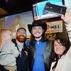 John Corey, 3, John and Alicia Callaher, of Daniels with Cody Wickline at Buffalo Wings.