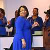 Brad Davis/The Register-Herald<br /> April Bright takes a quick look at the congregation behind her with a smile as she sings and leads the Heart of God Ministries Total Mass Choir during the church's Black History Month celebration Sunday evening.