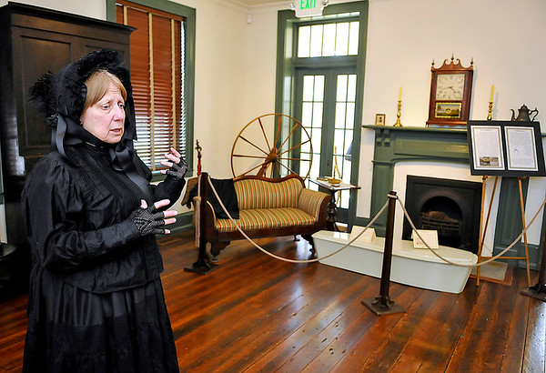 """Brad Davis/The Register-Herald<br /> Toni Ogden, Museum and Education Curator with the Greenbrier Historical Society, describes the North House Museum's latest exhibit, """"Mourning in America,"""" focusing on how our civilization has gone about dealing with death both in ritual and undertaking, particularly around the Victorian era, during the exhibit's opening day Sunday afternoon in Lewisburg."""