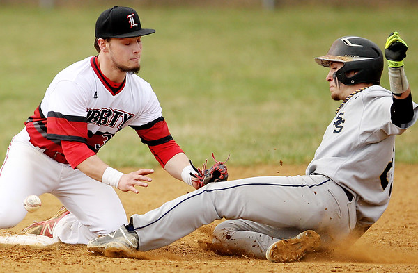 Chris Jackson/The Register-Herald<br /> Libertys's Jake Lacek (3) drops the ball as Shady Spring's (21) slides into second base on a steal during the second inning of their baseball game at Liberty on Tuesday.