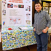 Brad Davis/The Register-Herald<br /> 10-year-old Mercer Elementary student Josiah Malachowsky poses for a quick photo with his his project on the recent Ebola outbreak during the Regional Education Service Agencies (RESA) Regional Social Studies Fair Saturday afternoon at the Beckley-Raleigh County Convention Center.