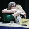 Brad Davis/The Register-Herald<br /> Wyoming East's Gabby Lupardus takes a brief moment to embrace her coach Angie Boninsegna during an emotional press conference following the Lady Warriors' one-point loss to Sissonville March 13.