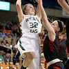 Brad Davis/The Register-Herald<br /> Wyoming East's Gabby Lupardus drives and scores against Sissionville in the State Tournament March 13.