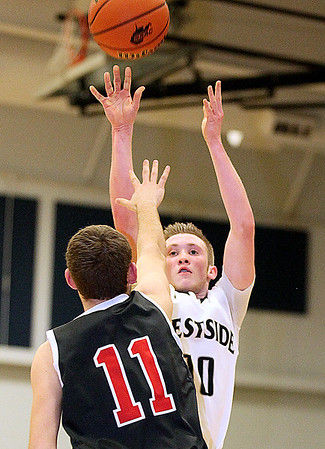 Brad Davis/The Register-Herald<br /> Westside's Will Fox shoots from three-point range before PikeView's Hunter Hill can get to him Wednesday night in Clear Fork.